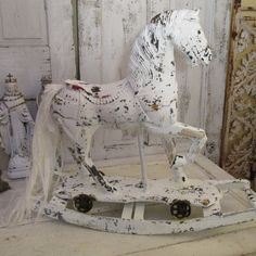 White rocking horse large vintage French Nordic wooden hand painted white distressed rusty wheels shabby cottage wood sculpture Anita Spero