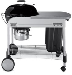 Weber grill with charcoal storage bin and work space. Perfect for small backyards