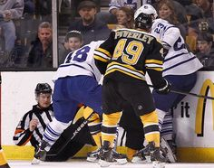 Toronto Maple Leafs at Boston Bruins Game L 4-2- 05/04/2013 An official falls to the ice as Ryan Hamilton #48 and Ryan O'Byrne #23 of the Toronto Maple Leafs and Rich Peverley #49 of the Boston Bruins fight for the puck in Game Two of the Eastern Conference Quarterfinals during the 2013 NHL Stanley Cup Playoffs at TD Garden in Boston, Massachusetts.  (Photo by Jim Rogash/Getty Images)