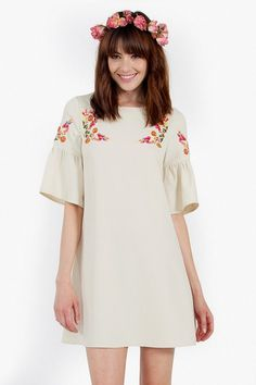 Bailamos Dress Shift dress with a bell sleeve. Features multicolored embroidery on the front and sleeves.