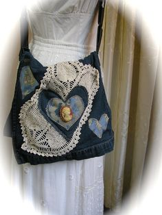Handmade Denim Bag, upcycled denim purse messenger crossover body strap doily embellished. $68.00, via Etsy.