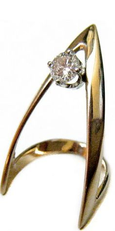 Gem Gossip Diamond Ring....this setting is just begging for a Trillion cut stone...