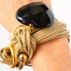 "Bartucciotto Tan and Black Charm Bracelet. Stunning Tan Bracelet by Bartucciotto. Details: Knotting cord with gold zamak closure and unique oversized natural stone charm. Handmade in Costa Rica. 7.75"" L approx. Bartucciotto Jewelry Bracelets"