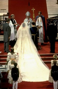 A view of Diana's twenty-five foot long detachable train (trimmed in lace) during the wedding ceremony. The Archbishop of Canterbury, Robert Runcie, presided over the couple's wedding.