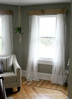 Wood valances with lace curtains and a hanging rope planter