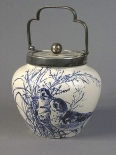 A Royal Doulton biscuit barrel, 9in. inc. handle