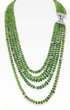 Peridot And Diamond Necklace Comprising Of Five Strands Of Faceted Peridot Beads, Accented At One Side With Circular-Cut Diamond Spacers, Joined By A Circular-Cut Diamond Clasp, Mounted In 18k White Gold Christie's