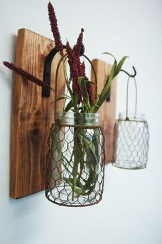Perfect Rustic Country mason jars wrapped in rusted chicken wire hanging on black wrought iron hooks from board stained in your choice of