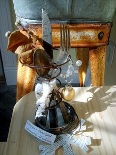 Love this collection...old washstand, bed spring & silverware!