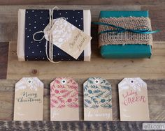 Christmas gift wrapping with colorful papers, tags and raffia