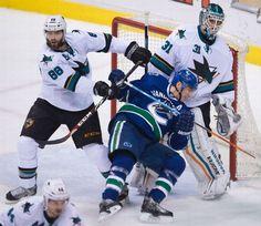 San Jose Sharks defenseman Brent Burns clears away Vancouver Canucks forward Alex Burrows (Feb. 5, 2015).