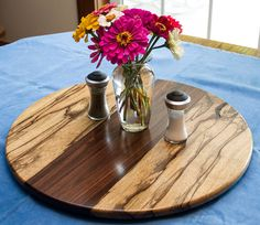 A Lazy Susan should be the center piece of the table. The striking contrast between the Black Limba and the Santos Rosewood sets this Lazy Susan apart from the others. These are exotic woods and they come from western Africa and Brazil. Price $135.00