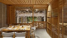 The result of a year-long research into traditional Japanese culture, Nozomi Sushi Bar in Valencia was designed by creative agency Masquespacio to look like an old Japanese village street.