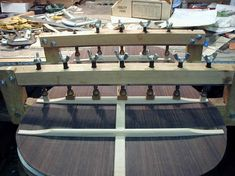 This is a jig for gluing back braces - note the curved bottom piece, which matches the curvature of the brace.