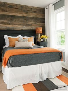 Wall of wood An accent wall of reclaimed floor boards softens this modern room and gives it cabin style. The rug, wall color, pillows, and bedding go perfectly with the color of the wood and keep the room feeling crisp and clean. Like for a guest room Home Bedroom, Master Bedroom, Bedroom Decor, Bedroom Ideas, Bedroom Designs, Gray Bedroom, Trendy Bedroom, Kids Bedroom, Bedroom Orange