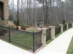 alum/metal fence with stone columns Brick Columns, Brick Fence, Front Yard Fence, Stone Pillars, Steep Hillside Landscaping, Fence Landscaping, Backyard Fences, Palisade Fence, Metal Fence Panels