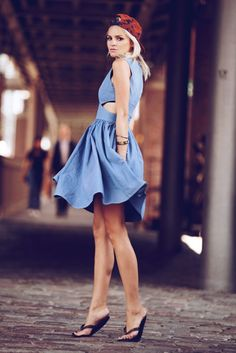 Stay stylish on busy days in a blue chambray skater dress. Dress down your look with black thong sandals.  Shop this look for $30:  http://lookastic.com/women/looks/black-thong-sandals-and-blue-chambray-skater-dress-and-red-print-cap/3455  — Black Thong Sandals  — Blue Chambray Skater Dress  — Red Print Cap