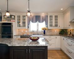 White Kitchen Cabinets With Dark Countertops | Black and white traditional kitchen cabinet 520x416 Black and White ...
