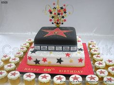 Hollywood Walk of Fame Cake. Two tier Hollywood Walk of Fame Star cake featuring the Boulevard granite star with movie icon and name. Topped with a wired red gold and black topper and surrounded with matching buttercream star cupcakes