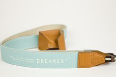 Introducing the Tokyo Dreamer Camera Strap. A fancifully foreign and fashion-forward strap with a handy little pocket for film or memory cards.