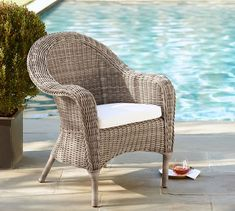 Torrey All-Weather Wicker Roll Arm Dining Chair - Natural | Pottery Barn Finally decided on these dining room chairs for the beach house patio!!!