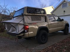 2016 Tacoma with A. ez up topper with integrated tent Toyota Autos, Toyota Trucks, Toyota Hilux, Toyota Tundra, Ford Trucks, Peterbilt Trucks, Toyota Tacoma Roof Rack, Toyota Tacoma Double Cab, Tacoma Truck