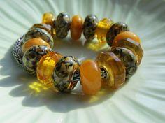 Trollbeads Amber & Wildcats beads