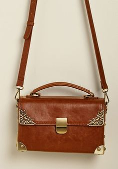 befe8dcadba Scrapbook Ending Bag in Brown - Your day of memory making with this cognac crossbody  bag