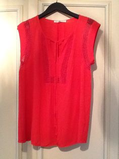 Red cheesecloth sleeveless top