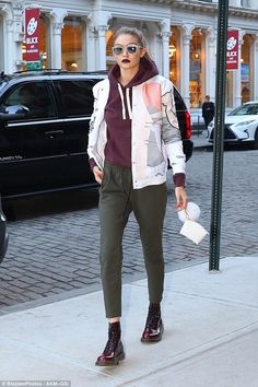 Dark side:Gigi Hadid rocked a stylish but edgy look as she wrapped a day of shooting in New York on Wednesday