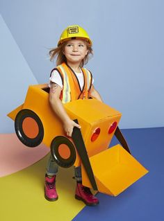 Step-by-step instructions to DIY a cardboard construction vehicle for your little worker's Halloween costume this year.