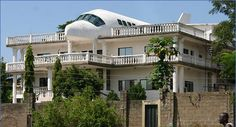 Airplane house (Abuja, Nigeria)  At first glance, this looks like a horrible plane crash! But it turns out this site was no accident. To honor his wife's love of travel, Said Jammal built their home in a shape of an airplane.