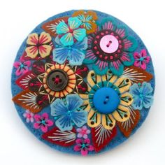 Felt embroidered flowers w/ button centers.