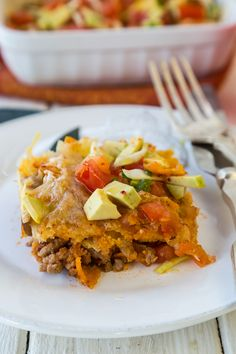 Taco casserole is one of our favorite scrumptious, decadent dishes, and we've made it easy for you to enjoy its spicy, cheesy, meat and tortilla goodness, without consuming a lifetime's worth of cholesterol, calories, and fat. #tacocasserole #tacos #casserole