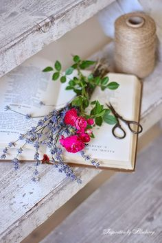 Love the white-washed wood grain, the pages of an old book and blooms!
