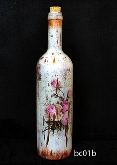 Upcycled Decorative Glass bottle with vintage style, perfect for candlestick, or deco. Decoupage technic, 30cm height, hand made in Greece. Unique present. Hand wash with cold water. Its not painted from the inside. I gladly accept returns and exchanges Contact me within:14 days of