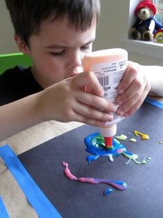 Colored glue investigations. Great fine motor practice squeezing the glue bottle.