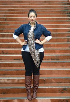 into. this. mixing patterns and brown boots over black jeans