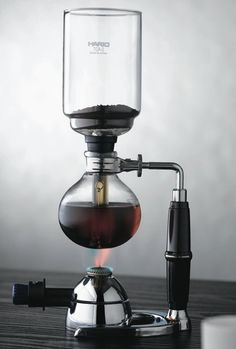 Any coffee maker that makes my kitchen look like a chemistry lab is a winner in my book. The Hario Syphon Vacuum Coffee Maker is a simple and clean machine, which apparently produces an incredibly smooth cup of coffee I Love Coffee, Coffee Time, Night Coffee, Fresh Coffee, Cafetiere Design, Coffee Drinks, Coffee Cups, Coffee Coffee, Coffee Americano