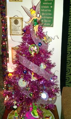 My Tinkerbell Christmas tree, full of tinkerbell ornaments, and some home made ornaments.