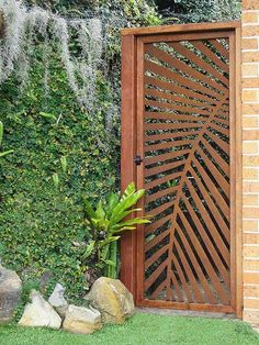 this is steel, but I don& see why you couldn& do this with exterior gr. - DOORS seen as amazing Art - this is steel, but I don& see why you couldn& do this with exterior grade plywood… le - Side Gates, Front Gates, Front Doors, Barn Doors, Tor Design, Gate Design, Leaf Design, Metal Gates, Metal Screen