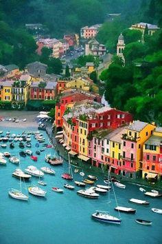 Portofino a posh fishing village on the Italian Riviera. I love the rainbow sherbert colors of the buildings. #italy #travel