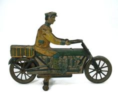 """Distler - Motorcyclist Motorcycle with Rider, Number 323W. Painted Tinplate with Clockwork Mechanism. Nuremberg, Germany. Circa 1920's. 4-1/2"""" x 6-1/2""""."""