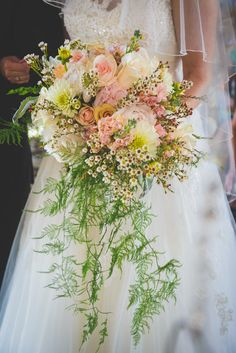 white yellow and peach cascading bouquet http://www.weddingchicks.com/2014/02/07/grand-bohemian-wedding/