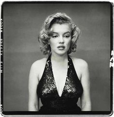 A rare picture of Marilyn Monroe without her signature smile. Photo by Richard Avedon, 1957.