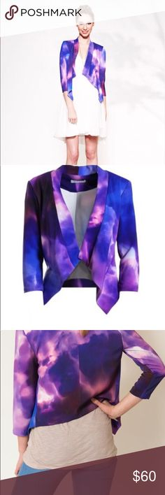 Askari Lennon Drape Jacket in Galaxy Print NWT Stand out in this trendy, digital printed, drape-front jacket with three-quarter sleeves. The print is a fun combination of shades of purple. Made by Shirin Askari, a top designer from Season 6 of Project Runway!   93% polyester, 7% spandex; lining: 100% polyester Body lined, not sleeves Slips on Made in U.S.A.  Askari products are made with custom printed fabric and each piece is hand cut, so the print will vary with each garment. This creation…