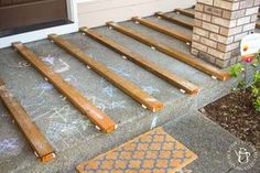 If you've ever thought about turning your cement porch into a wood deck, it's surprisingly easy! Here are some thoughts, tips, & photos from our experience! Concrete Patios, Deck Over Concrete, Concrete Front Porch, Front Deck, Front Porch Pergola, Front Porch Addition, Front Porch Steps, Porch Wood, Patio Slabs