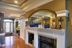 A fireplace and mantle in the great room of a home in Central New York