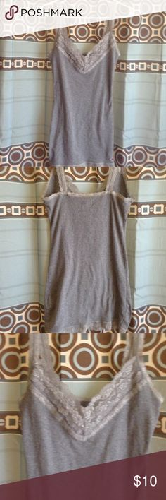 Hollister grey tank This is a beautiful and comfy tank from Hollister! I LOVE THIS TANK!! Wish it could fit me! Never been worn. In perfect condition! Offers and trades are accepted! Hollister Tops Tank Tops