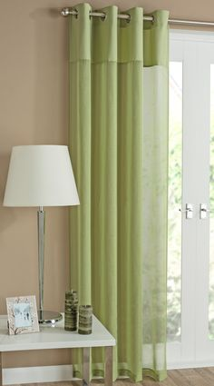 Rio Lime Green Eyelet Curtain. A modern and chic lime voile panel with a linen-look slub body and a striking deep silk heading with eyelet heading, suitable for all poles and rods